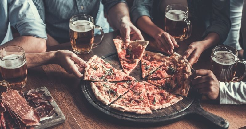 International pizza expo - 2020 speakers | close handsome young friends drinks beer | international pizza expo - 2020