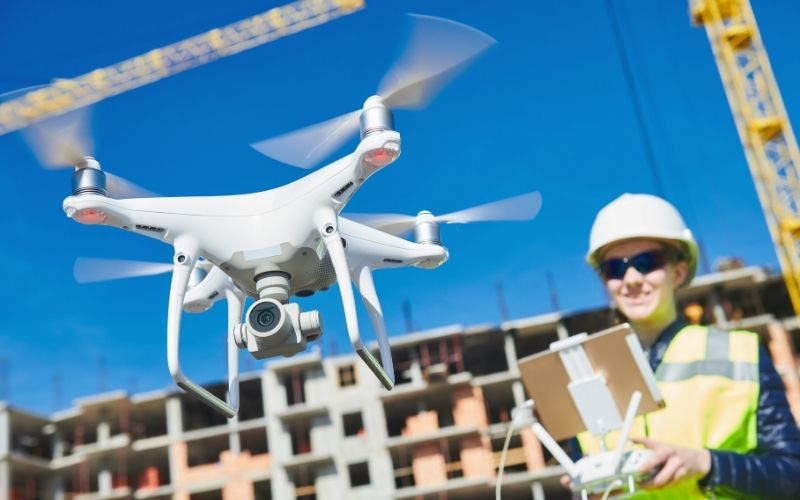 drone operated by construction female worker | Commercial UAV Expo Americas 2020