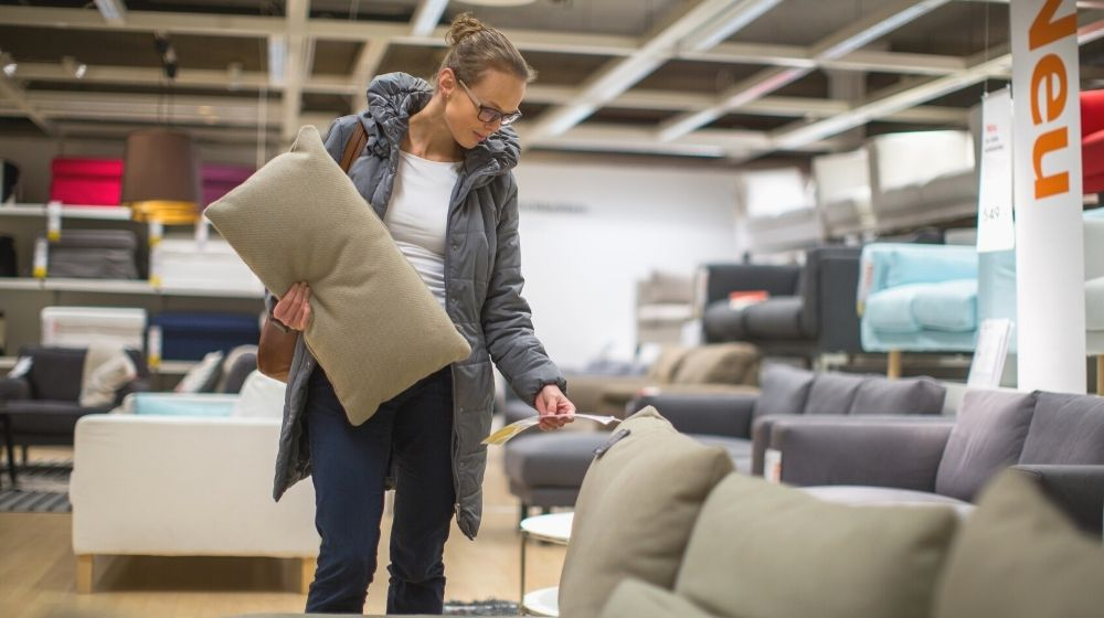 Pretty young woman choosing right furniture | las vegas market summer 2021 | featured